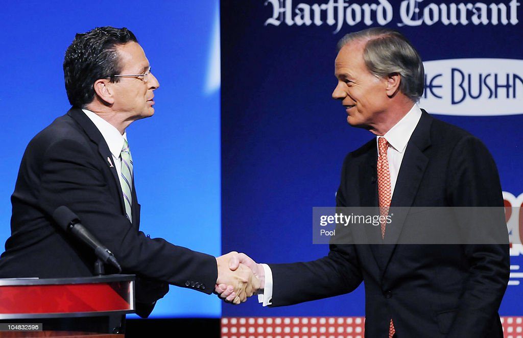 Stamford Mayor and Democratic nominee Dannel Malloy and former US Ambassador to Ireland businessman and Republican nominee Tom Foley shake hands...