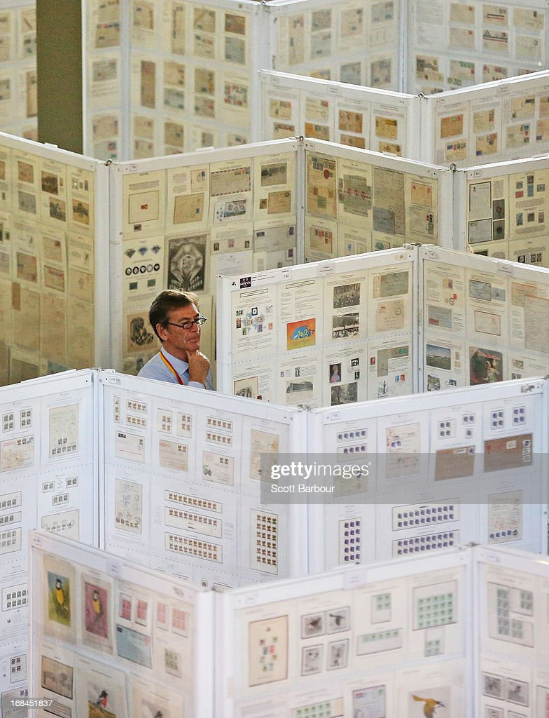 A stamp collector examines stamps on display at the World Stamp Expo on May 10, 2013 in Melbourne, Australia. The World Stamp Expo is the largest exhibition of its kind in Australia and the second largest ever held in the world.