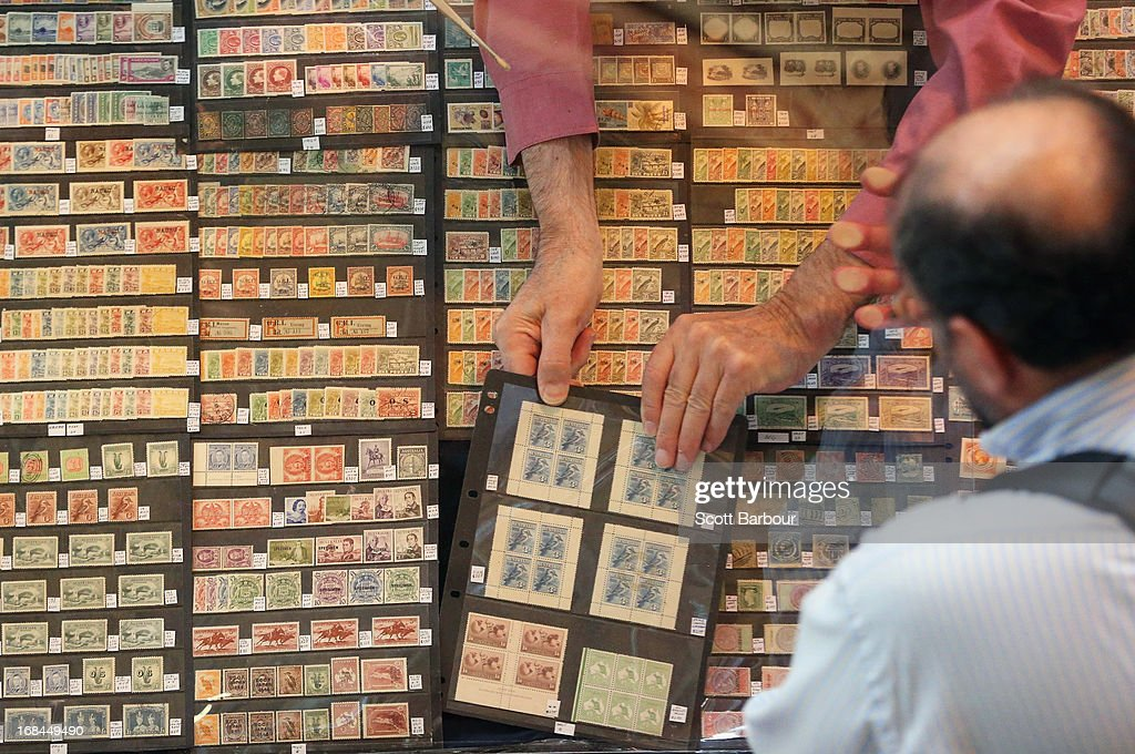Stamp collectors examine and purchase stamps on display at the World Stamp Expo on May 10, 2013 in Melbourne, Australia. The World Stamp Expo is the largest exhibition of its kind in Australia and the second largest ever held in the world.