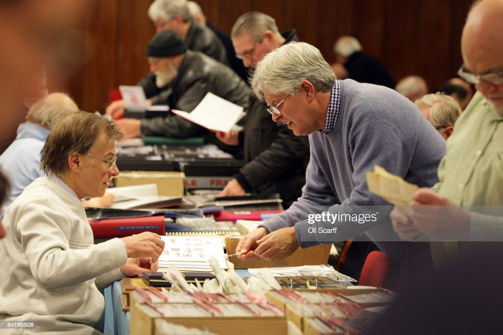 Stamp collectors look through boxes of stamps for sale at the Strand Stamp Show in the Royal National Hotel on January 7, 2008 in London, England. The monthly Strand Stamp Show held in London attracts philatelist dealers and collectors from around the country.