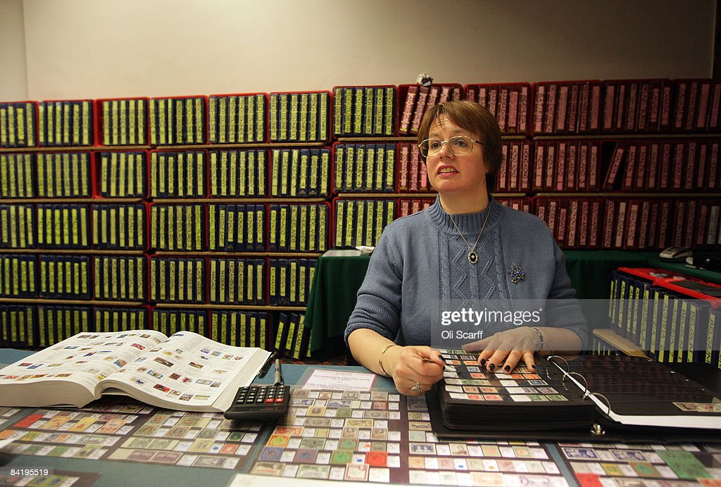 Stamp dealer, Liz Ashfield, sits at her stall at the Strand Stamp Show in the Royal National Hotel on January 7, 2008 in London, England. The monthly Strand Stamp Show held in London attracts philatelist dealers and collectors from around the country..