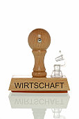 Stamp with the word Wirtschaft, economy with an open valve, symbolic image for the economy running out of air