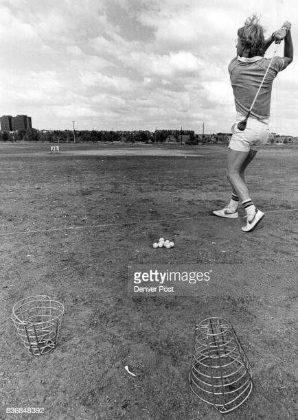 Stan Anderson hits a few before a round at the JFK golf course The driving range lacks much of anything in the way turf Credit The Denver Post