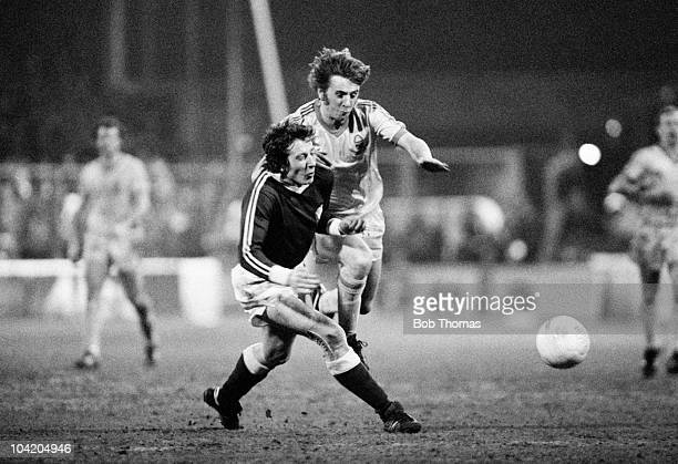 Stan Bowles of Nottingham Forest clashes with a Dynamo Berlin defender during the Nottingham Forest v Dynamo Berlin European Cup Quarter Final 1st...
