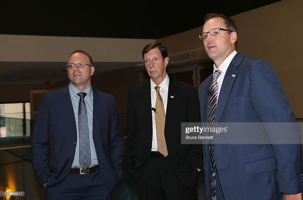 Stan Bowman, David Poile and Dan Bylsma attend a press conference for the 2014 Men's Olympic Hockey Team at the Marriott Marquis Hotel on June 29, 2013 in New York City.