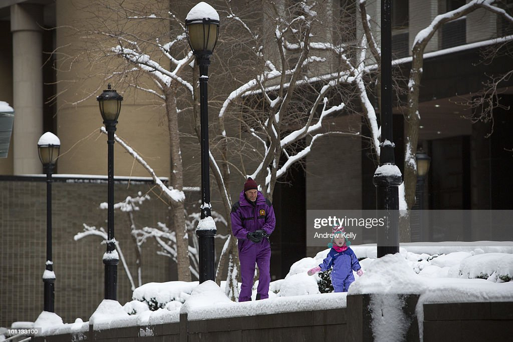 Stan Erdreich chases his daughter Marlee Bea through snow following a major winter storm on February 9, 2013 in New York City. New York City and much of the Northeast received a foot or more of snow through Saturday morning with possible record-setting blizzard conditions expected. Heavy snow warnings are in effect from New Jersey through southern Maine.