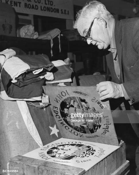 Stan Harvey stamps the John Edgington logo onto a crate at the company's premises on the Old Kent Road London 5th May 1971 The famous flagmakers are...