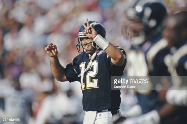 Stan Humphries Quarterback for the San Diego Chargers calls a play from the instructions on his left forearm during the American Football Conference...