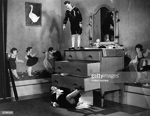 Stan Laurel and Oliver Hardy as they appear in the comedy 'Brats' in which they play their own sons The film was directed by James Parrott for Hal...