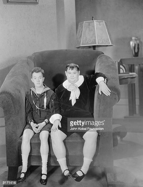 Stan Laurel and Oliver Hardy playing their own sons on an oversized set as they appear in 'Brats' directed by James Parrott