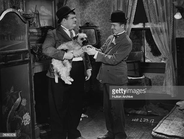 Stan Laurel and Oliver Hardy star in the Hal Roach film 'Laughing Gravy' in which the disastrous duo become involved with a small mongrel The film...