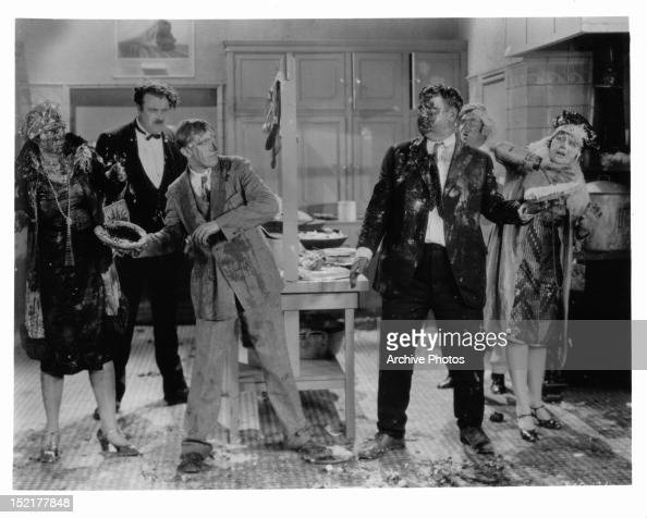 Stan Laurel and Oliver Hardy throwing pies at each other in a scene from the short 'Their Purple Moment' 1928