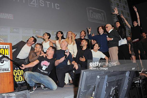 Stan Lee appears in a selfie with cast and crew of FOX superhero movies onstage at the 20th Century FOX panel during ComicCon International 2015 at...