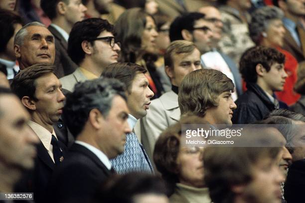 Stan Mikita and Bobby Orr of Canada sit in the stands during a game in the 1972 Summit Series between Canada and the Soviet Union at the Luzhniki Ice...