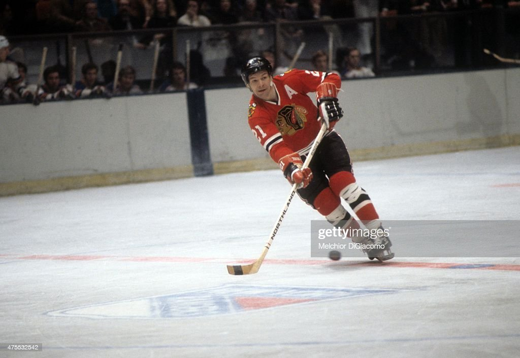<a gi-track='captionPersonalityLinkClicked' href=/galleries/search?phrase=Stan+Mikita&family=editorial&specificpeople=1691052 ng-click='$event.stopPropagation()'>Stan Mikita</a> #21 of the Chicago Blackhawks passes the puck during an NHL game against the New York Rangers circa 1972 at the Madison Square Garden in New York, New York.