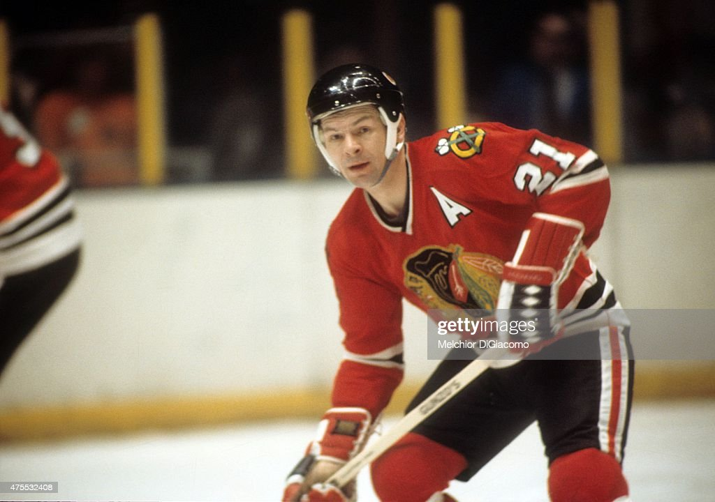 <a gi-track='captionPersonalityLinkClicked' href=/galleries/search?phrase=Stan+Mikita&family=editorial&specificpeople=1691052 ng-click='$event.stopPropagation()'>Stan Mikita</a> #21 of the Chicago Blackhawks skates on the ice during an NHL game against the New York Rangers circa 1974 at the Madison Square Garden in New York, New York.