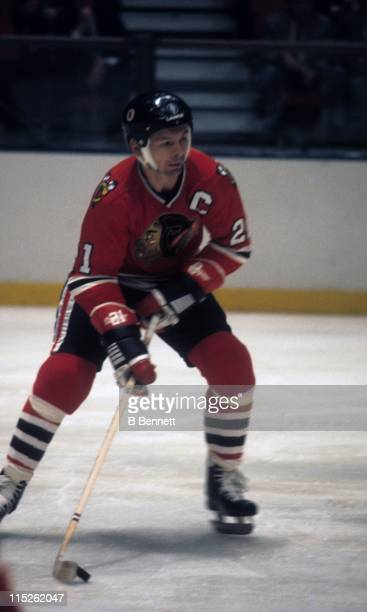 Stan Mikita of the Chicago Blackhawks skates with the puck during an NHL game against the New York Rangers on October 8 1975 at the Madison Square...