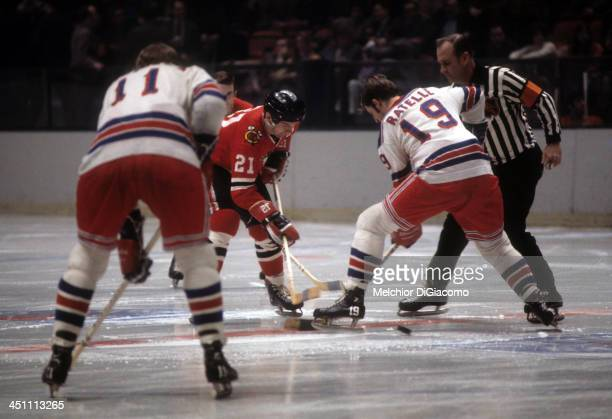 Stan Mikita of the Chicago Blackhawks takes the faceoff against Jean Ratelle of the New York Rangers circa 1972 at the Madison Square Garden in New...