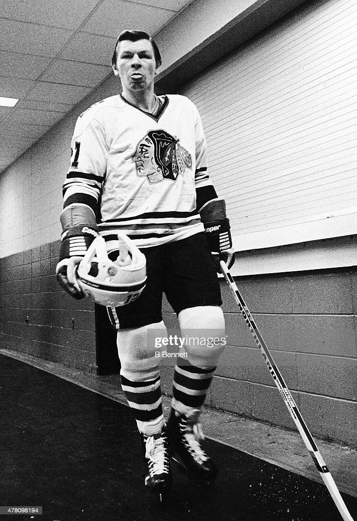 <a gi-track='captionPersonalityLinkClicked' href=/galleries/search?phrase=Stan+Mikita&family=editorial&specificpeople=1691052 ng-click='$event.stopPropagation()'>Stan Mikita</a> #21 of the Chicgao Blackhawks walks out to play against the New York Islanders while sticking his tongue out at the photographer on January 1, 1975 at the Nassau Coliseum in Uniondale, New York.