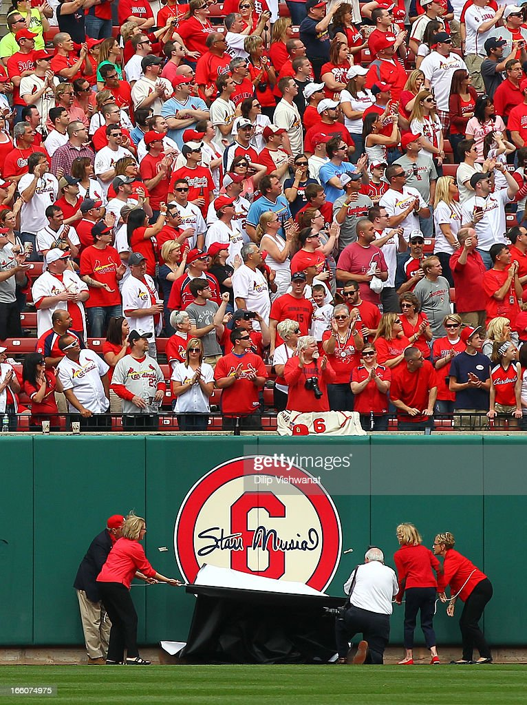 Stan Musial's family unveils a sign in the outfield wall before the game between the St. Louis Cardinals and the Cincinnati Reds during Opening Day on April 8, 2013 at Busch Stadium in St. Louis, Missouri.