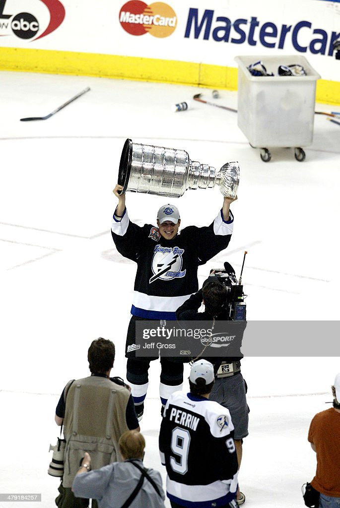 <a gi-track='captionPersonalityLinkClicked' href=/galleries/search?phrase=Stan+Neckar&family=editorial&specificpeople=226864 ng-click='$event.stopPropagation()'>Stan Neckar</a> #2 of the Tampa Bay Lightning celebrates with the Stanley Cup trophy after defeating the Calgary Flames 2-1 to win game seven of the NHL Stanley Cup Finals on June 7, 2004 at the St. Pete Times Forum in Tampa, Florida