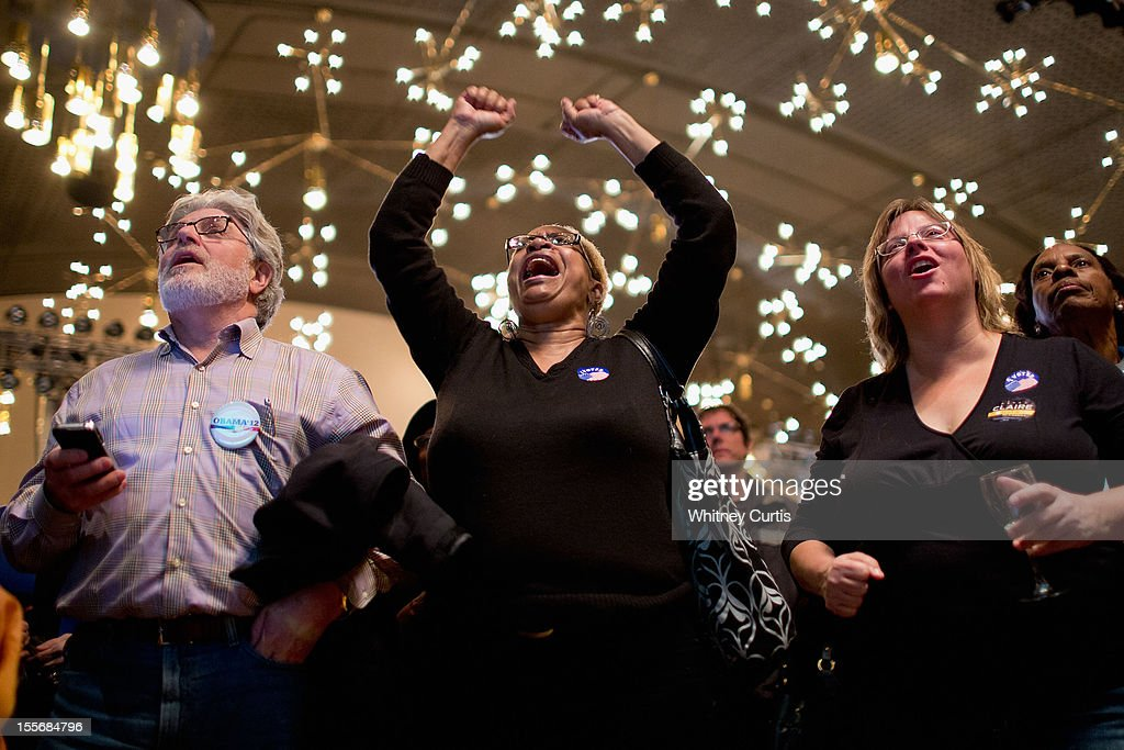 Stan Shanker, Denise Pearson and Michelle Zielinski react to early presidential election returns during an election night watch party for Sen. Claire McCaskill (D-MO) November 6, 2012 in St. Louis, Missouri. McCaskill won in her re-election bid against U.S. Rep. Todd Akin (R-MO) for the Missouri U.S. senate seat, according to broadcast reports.