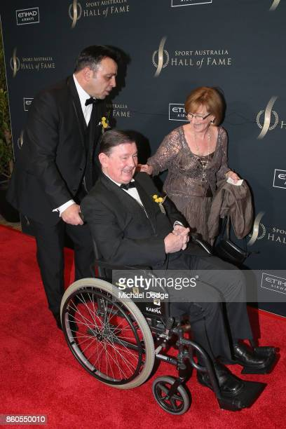Stan ''The Man'' Longinidis arrives with legend boxer John Famechon and his wife Glenys at the Sport Australia Hall of Fame Annual Induction and...