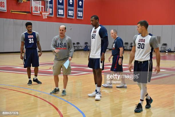 Stan Van Gundy coaches Jonathan Holmes of the USA AmeriCup Team during a training camp at the University of Houston in Houston Texas on August 23...