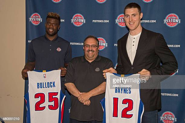 Stan Van Gundy introduces new players Reggie Bullock and Aron Baynes of the Detroit Pistons during a press conference on July 12 2015 at the Palace...