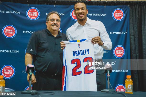 Stan Van Gundy president of basketball operations of the Detroit Pistons present Avery Bradley his jersey during a press conference on July 13 2017...