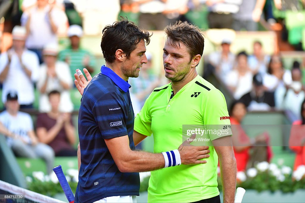 Stan Wawrinka consoles Jeremy Chardy after their match during the Men's Singles third round on day six of the French Open 2016 at Roland Garros on May 27, 2016 in Paris, France.