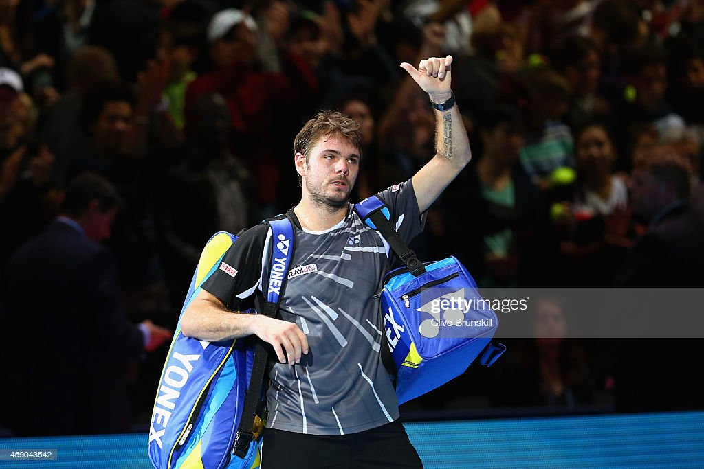 Stan Wawrinka of Switzerland acknowledges the crowd after defeat in the singles semifinal match against Roger Federer of Switzerland on day seven of...
