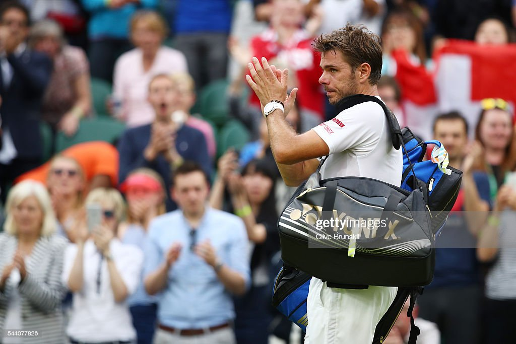 Stan Wawrinka of Switzerland applauds supporters following defeat in the Men's Singles second round match against Juan Martin Del Potro of Argentina on day five of the Wimbledon Lawn Tennis Championships at the All England Lawn Tennis and Croquet Club on July 1, 2016 in London, England.