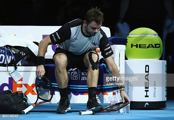 Stan Wawrinka of Switzerland breaks his racket in his men's singles match against Andy Murray of Great Britain on day six of the ATP World Tour...