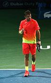 Stan Wawrinka of Switzerland celebrates beating Sergiy Stakhovsky of Ukraine during day four of the ATP Dubai Duty Free Tennis Championship at the...