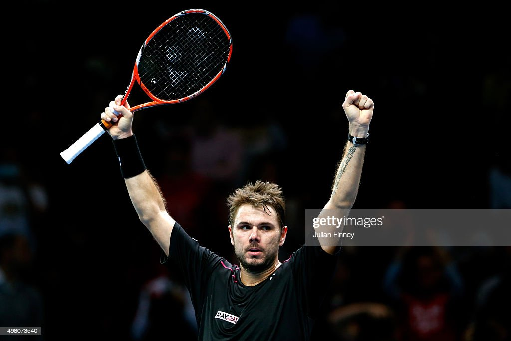 Stan Wawrinka of Switzerland celebrates his victory during the men's singles match against Andy Murray of Great Britain on day six of the Barclays...