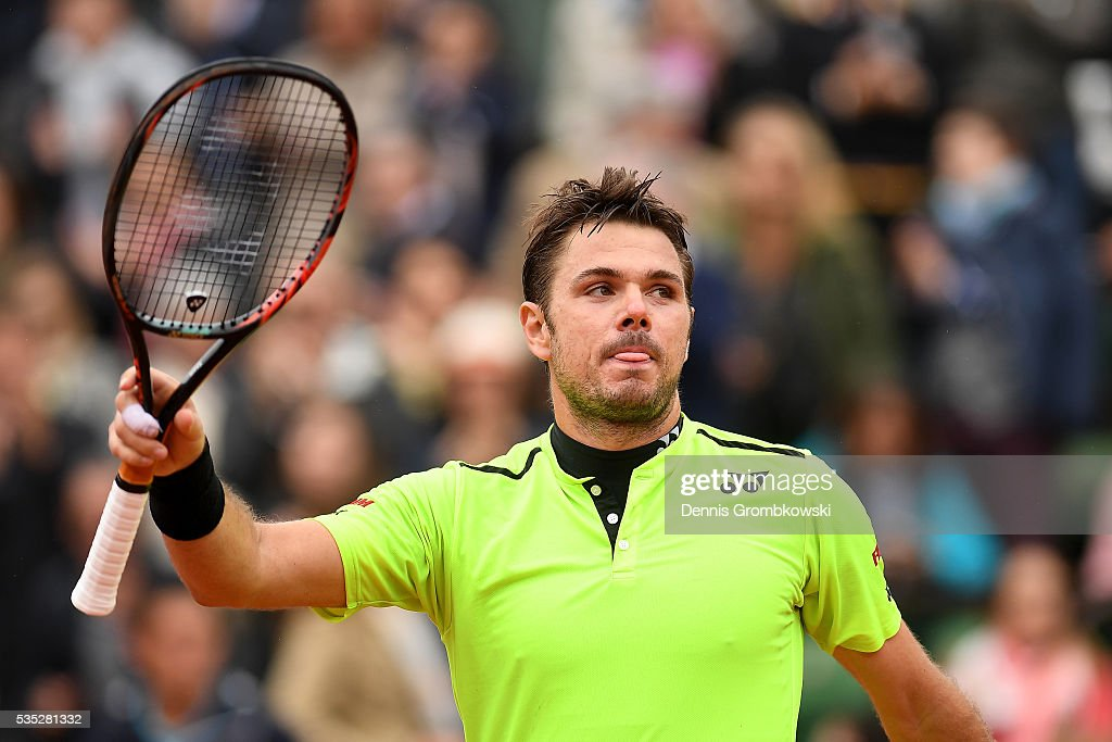 Stan Wawrinka of Switzerland celebrates victory during the Men's Singles fourth round match against Viktor Troicki of Serbia on day eight of the 2016 French Open at Roland Garros on May 29, 2016 in Paris, France.
