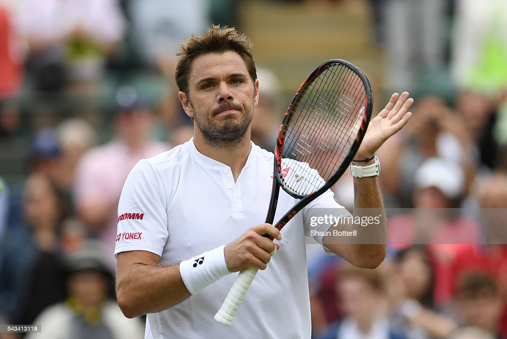 Stan Wawrinka of Switzerland celebrates victory during the Men's Singles first round match against Taylor Fritz of The United States on day two of the Wimbledon Lawn Tennis Championships at the All England Lawn Tennis and Croquet Club on June 28, 2016 in London, England.