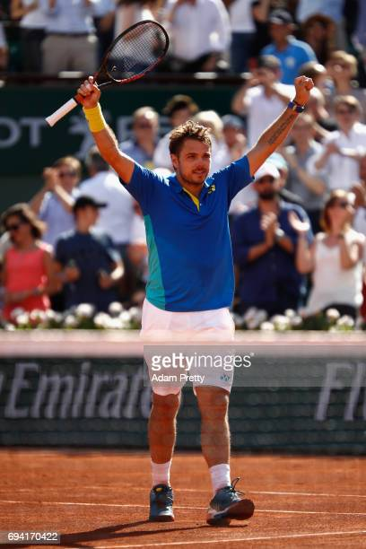 Stan Wawrinka of Switzerland celebrates victory following the mens singles semifinal match against Andy Murray of Great Britain on day thirteen of...