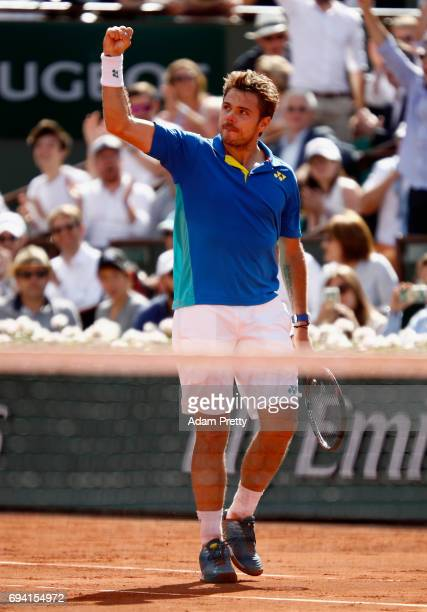 Stan Wawrinka of Switzerland celebrates winning a set during mens singles semifinal match against Andy Murray of Great Britain on day thirteen of the...