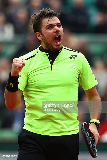 Stan Wawrinka of Switzerland celebrates winning the third set during the Men's Singles semi final match against Andy Murray of Great Britain on day...