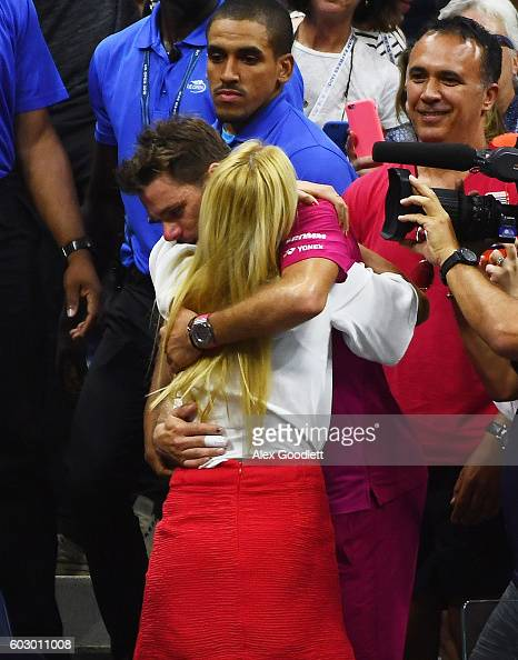 Stan Wawrinka of Switzerland celebrates with his girl friend Donna Vekic after defeating Novak Djokovic of Serbia with a score of 67 64 75 63 during...