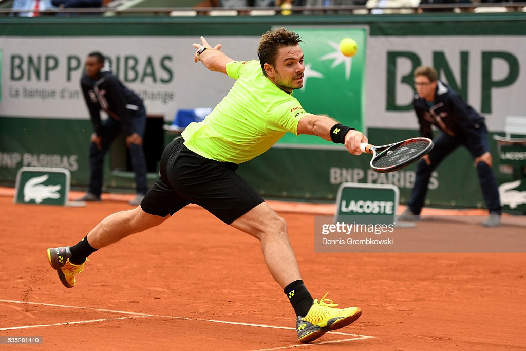Stan Wawrinka of Switzerland hits a backhand during the Men's Singles fourth round match against Viktor Troicki of Serbia on day eight of the 2016 French Open at Roland Garros on May 29, 2016 in Paris, France.