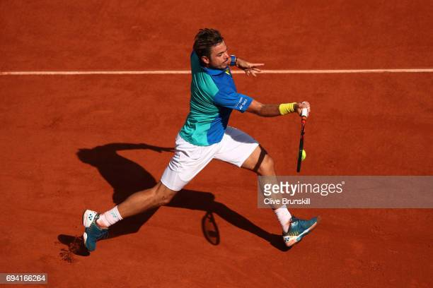 Stan Wawrinka of Switzerland hits a forehand during the men's singles semi final match against Andy Murray of Great Britain on day thirteen of the...