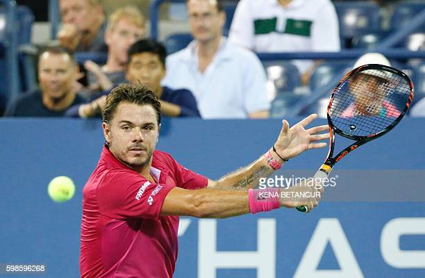Stan Wawrinka of Switzerland hits a return against Alessandro Giannessi of Italy during their 2016 US Open Men's Singles match at the USTA Billie...