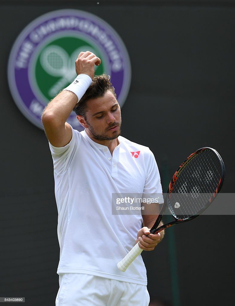Stan Wawrinka of Switzerland looks dejected during the Men's Singles first round match against Taylor Fritz of The United States on day two of the Wimbledon Lawn Tennis Championships at the All England Lawn Tennis and Croquet Club on June 28, 2016 in London, England.
