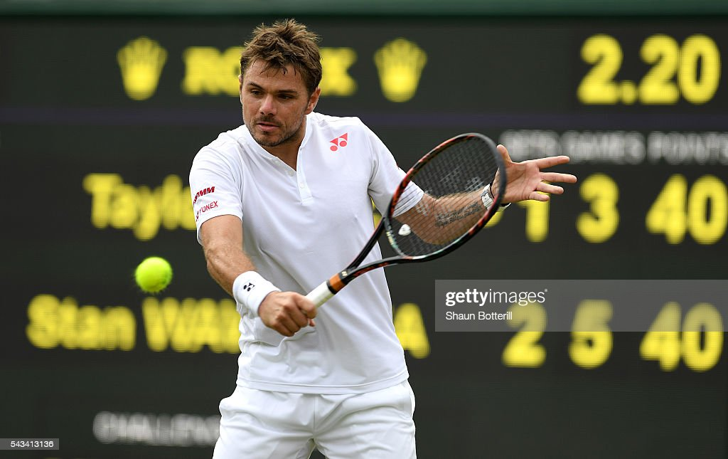 Stan Wawrinka of Switzerland lplays a backhand during the Men's Singles first round match against Taylor Fritz of The United States on day two of the Wimbledon Lawn Tennis Championships at the All England Lawn Tennis and Croquet Club on June 28, 2016 in London, England.