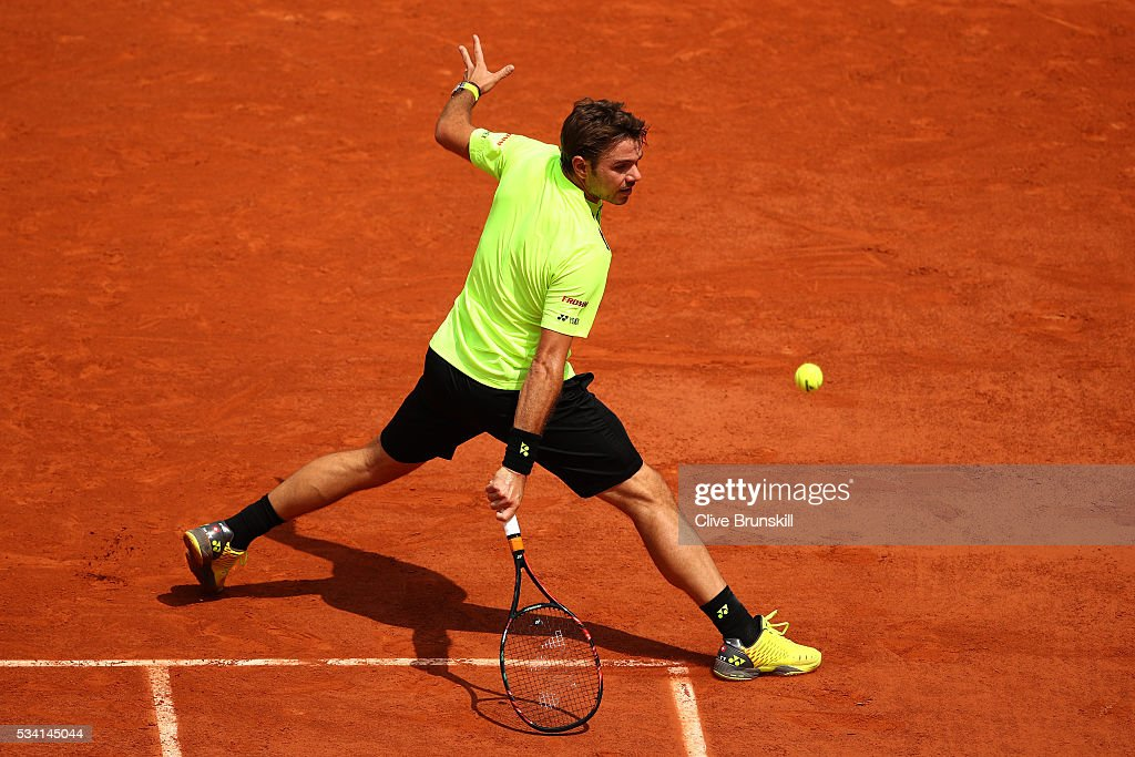 Stan Wawrinka of Switzerland plays a backhand during the Men's Singles second round match against Taro Daniel of Japan on day four of the 2016 French Open at Roland Garros on May 25, 2016 in Paris, France.