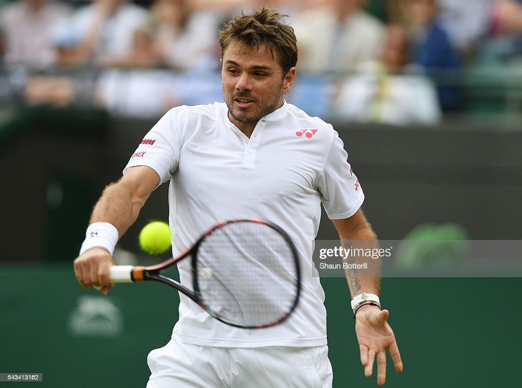 Stan Wawrinka of Switzerland plays a backhand during the Men's Singles first round match against Taylor Fritz of The United States on day two of the Wimbledon Lawn Tennis Championships at the All England Lawn Tennis and Croquet Club on June 28, 2016 in London, England.
