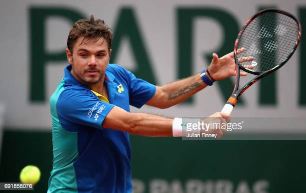 Stan Wawrinka of Switzerland plays a backhand during the mens singles third round match against Fabio Fognini of Italy on day seven of the 2017...